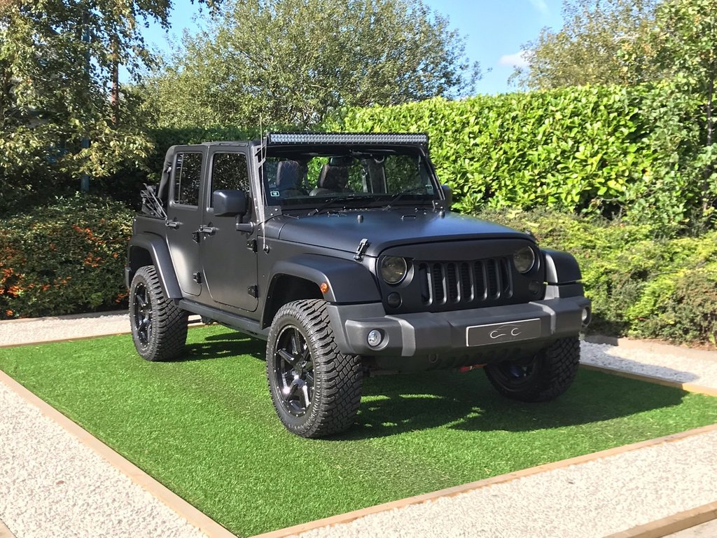 USED 2018 18 JEEP WRANGLER 2.8 CRD NIGHT EAGLE UNLIMITED 4d AUTO 197 BHP A UNIQUE HIGH QUALITY CONVERSION WITH DESIRABLE ENHANCEMENTS FULL BESPOKE INTERIOR WITH HEATED BLACK QUILTED LEATHER WITH RED STITCHING HUGELY VERSATILE AND A FULL FOUR SEAT FOUR DOOR CONVERTABLE UPRATED SPRINGS AND DAMPERS FOR HIGHER GROUND CLEARANCE 20 INCH GLOSS ALLOYS  POWERFUL 180 LED LIGHT BAR FRONTp EYEBROW SUBWOOFER SAT NAV BLUETOOTH VOICE ACTIVATION CRUISE REMOVABLE HARDTOP PLUS EASY FOLD SOFT TOP