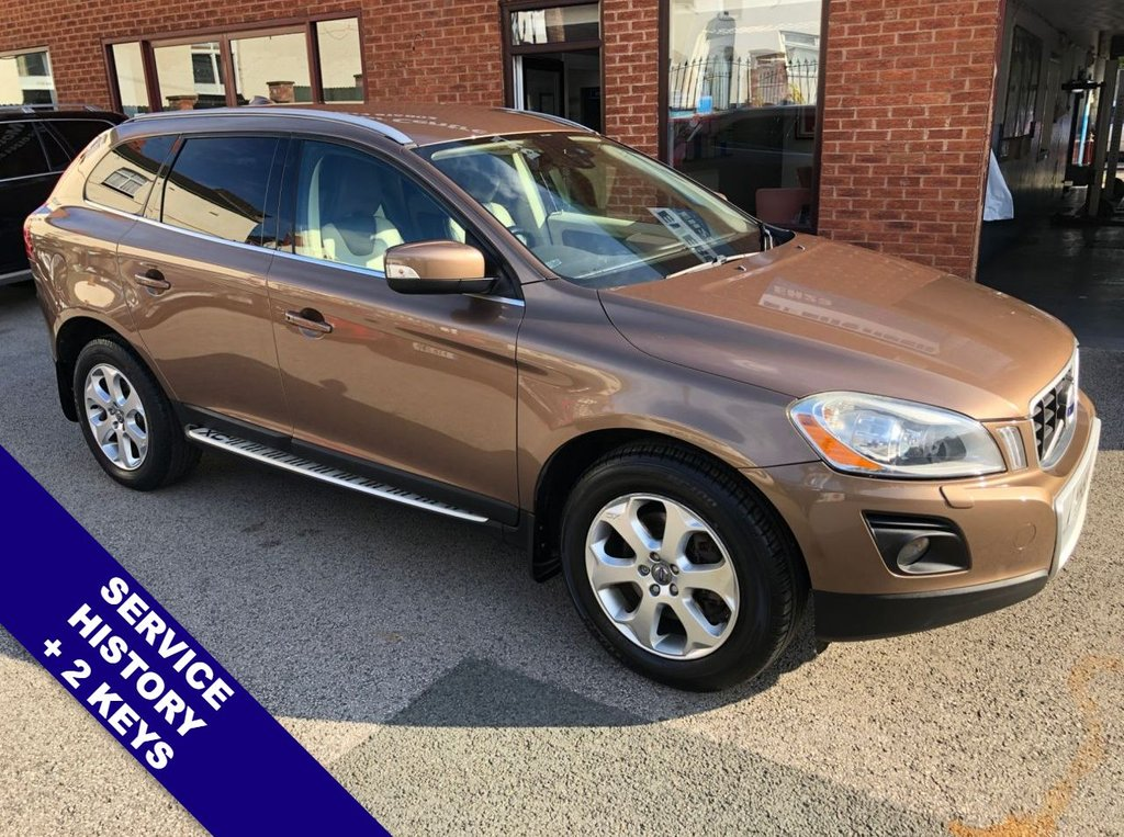 "USED 2009 59 VOLVO XC60 2.4 D5 SE LUX AWD 5DOOR AUTO 205 BHP USB & AUX   :   Cruise Control   :   Bluetooth   :   Climate Control / Air Conditioning      Heated & Electric Front Seats   :   Front & Rear Electric Windows   :   Rear Parking Sensors     18"" Alloy Wheels   :   2 Keys   :   Terra Bronze Metallic Paintwork   :   Service History"