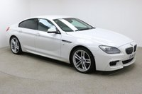 "USED 2015 15 BMW 6 SERIES GRAN COUPE 3.0 640D M SPORT GRAN COUPE 4d AUTO 309 BHP Finished in stunning Alpine White Metallic with Black Leather Seats, 20"" Alloy Wheels, Privacy Glass, Parking Sensors, Reversing Camera, Xenon Headlights, Surround Parking Camera and Full BMW Service History. Sat Nav, Bluetooth, DAB Radio, Stop/Start, Air Con, Climate Control, Multi Function Wheel, Cruise Control, Electric Mirrors and Windows"