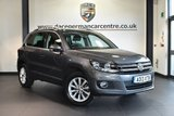 "USED 2013 13 VOLKSWAGEN TIGUAN 2.0 SE TDI BLUEMOTION TECHNOLOGY 4MOTION DSG 5DR AUTO 138 BHP full service history * NO ADMIN FEES * FINISHED IN STUNNING GREY WITH CLOTH UPHOLSTERY + FULL SERVICE HISTORY + BLUETOOTH + DAB RADIO + AIR CONDITIONING + HEATED MIRRORS + PARKING SENSORS + 17"" ALLOY WHEELS"