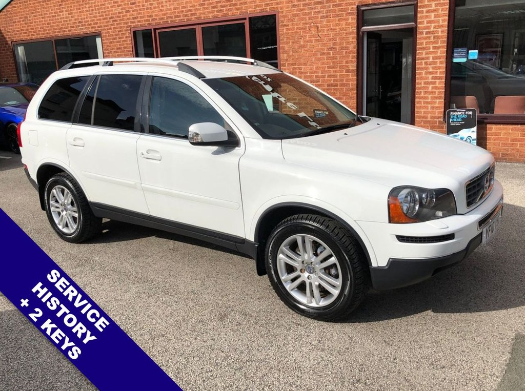 """USED 2010 10 VOLVO XC90 2.4 D5 SE AWD 5DOOR AUTO 185 BHP Family 7-Seater   :   AUX Socket   :   Cruise Control   :   Phone Bluetooth Connectivity      Climate Control / Air Conditioning     :     Heated Front Seats     :     Electric Driver Seat     Black Leather Upholstery   :   Rear Parking Sensors   :   18"""" Alloy Wheels   :   Service History"""
