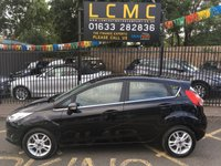 USED 2016 66 FORD FIESTA 1.0 ZETEC 5d 99 BHP STUNNING SHADOW BLACK METALLIC WITH LUXURY BLACK CLOTH UPHOLSTERY. ONLY TWO OWNERS FROM NEW. FULL SERVICE HISTORY. BRAND NEW MOT ON PURCHASE. LAST SERVICED 22/06/2019. AIR CONDITIONING. DAB RADIO. BLUETOOTH. ELECTRIC WINDOWS. REMOTE CENTRAL LOCKING WITH TWO KEYS. PLEASE GOTO www.lowcostmotorcompany.co.uk TO VIEW OVER 120 CARS IN STOCK.