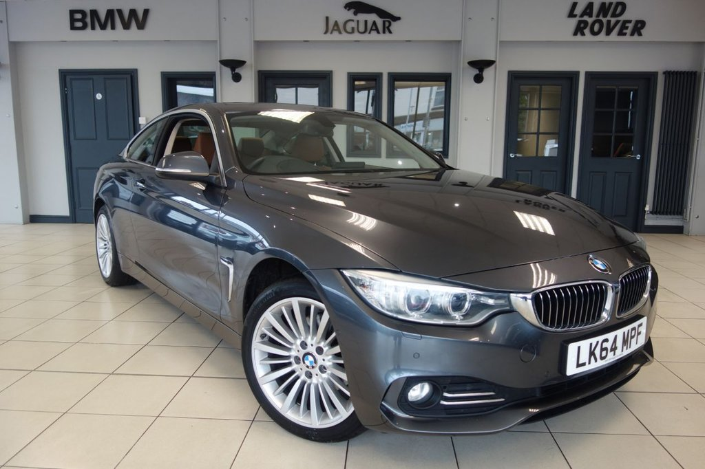 USED 2015 64 BMW 4 SERIES 2.0 420D XDRIVE LUXURY 2d 181 BHP FINISHED IN STUNNING MINERAL GREY WITH BROWN LEATHER UPHOLSTERY + FULL BMW SERVICE HISTORY + PRO SATELLITE NAVIGATION + HEAD UP DISPLAY + REVERSING CAMERA + HEATED SEATS + SPORTS SEATS + PARKING ASSIST + XENON LIGHTS + LIGHT PACKAGE + CRUISE CONTROL + DAB DIGITAL RADIO + BLUETOOTH + AIR CONDITIONING