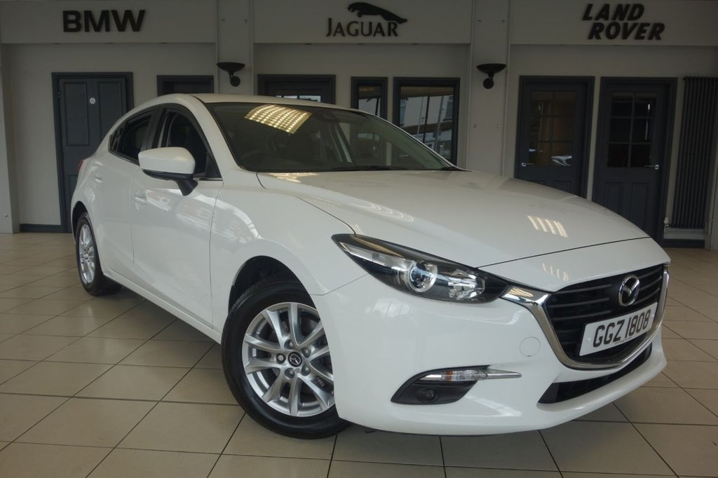 USED 2017 MAZDA 3 2.0 SE-L NAV 5d 118 BHP FINISHED IN STUNNING WHITE WITH CLOTH UPHOLSTERY + FULL MAZDA SERVICE HISTORY + SATELLITE NAVIGATION + HEATED SEATS + PARKING SENSORS + CLIMATE CONTROL + AUX/USB INPUT + CRUISE CONTROL + AIR CONDITIONING