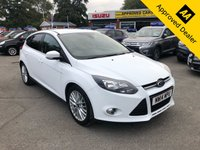 USED 2014 14 FORD FOCUS 1.0 ZETEC NAVIGATOR 5d 99 BHP IN WHITE PETROL SAT NAV FULL SERVICE HISTORY IMMACULATE CONDITION ULEZ COMPLIANT  APPROVED CARS AND FINANCE ARE PLEASED TO OFFER THIS FORD FOCUS 1.0 ZETEC NAVIGATOR 5d 99 BHP IN WHITE PETROL. THIS CAR IS ULEZ COMPLIANT AND COMES WITH A GREAT SPEC INCLUDING ABS,ALLOY WHEELS,ELECTRIC WINDOWS,ELECTRIC MIRRORS,AIR CON,SAT NAV,CD PLAYER,FULL FORD SERVICE HISTORY WITH 6 MAIN DEALER STAMPS AND MUCH MORE.