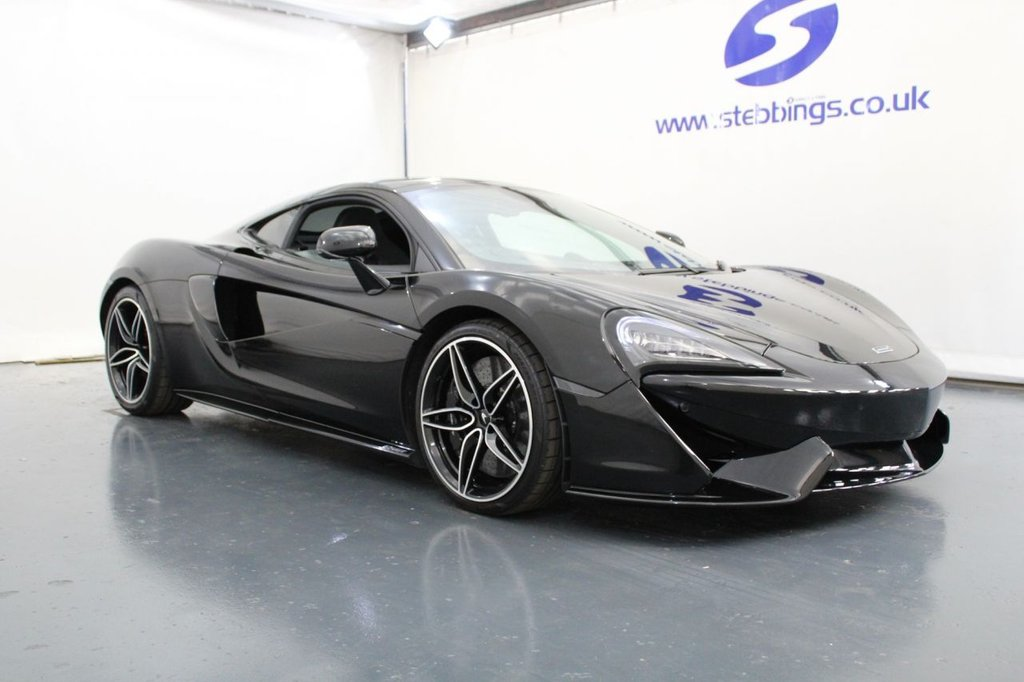 """USED 2019 68 MCLAREN 570GT  MSO BLACK COLLECTION.CPE S-A. 1 OF 100 LIMITED EDITION SATELLITE NAVIGATION, JET BLACK LEATHER, GT UPGRADE PACK INCORPORATING VEHICLE LIFT, REAR VIEW CAMERA, 12 SPEAKER BOWER AND WILSON AUDIO SYSTEM, PANORAMIC GLASS ROOF, MSO DEFINED TITANIUM SUPERSPORTS EXHAUST, SOFT CLOSE DOORS, POWER HEATED MEMORY SEATS, CARBON FIBRE SWITCH PACK, VEHICLE TRACKING SYSTEM, CERAMIC BRAKES, DIGITAL INSTRUMENT PANEL, AUTO WIPERS, BLACK AND DIAMOND CUT ALLOY WHEELS, 19"""" FRONT / 20"""" REAR."""
