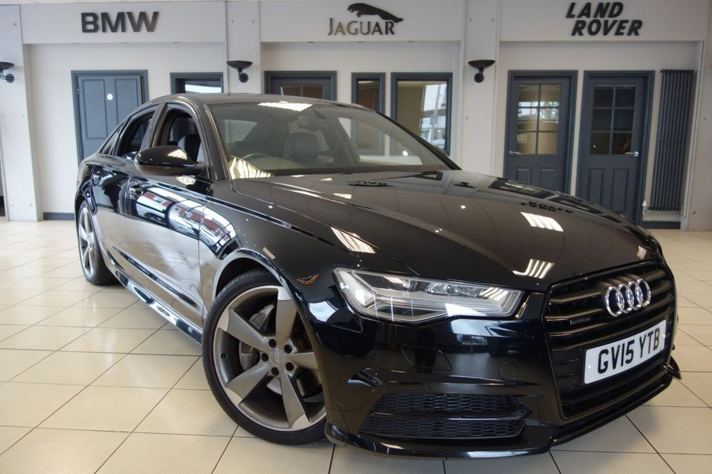 """USED 2015 15 AUDI A6 3.0 TDI QUATTRO BLACK EDITION 4d AUTO 320 BHP ** NEW SHAPE ** FINISHED IN STUNNING BRILLIANT BLACK WITH BLACK LEATHER UPHOLSTERY + STUNNING NEW SHAPE A6 + FULL AUDI SERVICE HISTORY + 1 OWNER FROM NEW + SATELLITE NAVIGATION + HEATED FRONT SEATS + REAR PRIVACY GLASS + ELECTRIC FRONT SEATS + AUDI MUSIC INTERFACE + CRUISE CONTROL + DAB DIGITAL RADIO + BLUETOOTH + CLIMATE CONTROLLED DUAL ZONE AIR CONDITIONING + 20"""" ALLOY WHEELS"""