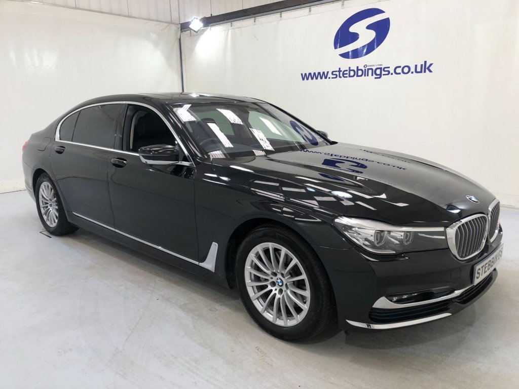 """USED 2016 16 BMW 7 SERIES 3.0 740LI 4d AUTO 322 BHP BMW PROFESSIONAL NAVIGATION, BLACK QUILTED LEATHER, POWER HEATED AND COOLING  COMFORT MASSAGE SEATS ALL WITH INDIVIDUAL MEMORY, REAR MEDIA SCREENS WITH HEADPHONES AND REMOTE CONTROL, HARMAN KARDON SURROUND SOUND SYSTEM, PARKING SENSORS WITH SURROUND VIEW, SOFT CLOSE DOORS, QUAD ZONE CLIMATE CONTROL, TV FUNCTION, TELEPHONY WITH WIRELESS CHARGING, COMFORT ACCESS, KEYLESS START, 18"""" MULTISPOKE ALLOYS"""