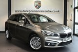 """USED 2015 64 BMW 2 SERIES ACTIVE TOURER 2.0 218D LUXURY ACTIVE TOURER 5DR AUTO 148 BHP full service history Finished in a stunning platinum metallic silver styled with 17"""" alloys. Upon opening the drivers door you are presented with full leather interior, full service history, satellite navigation, bluetooth, heated seats, dab radio, performance control, auto air con, rain sensors, fog lights, parking sensors"""