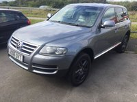 USED 2006 06 VOLKSWAGEN TOUAREG 3.0 V6 TDI SPORT 5d 221 BHP SATNAV LEATHER MOT 05/20 4WD. SATELLITE NAVIGATION. STUNNING GREY MET WITH FULL GREY LEATHER TRIM. ELECTRIC MEMORY HEATED SEATS. CRUISE CONTROL. 18 INCH ALLOYS. COLOUR CODED TRIMS. PRIVACY GLASS. PARKING SENSORS. BLUETOOTH PREP. CLIMATE CONTROL. MFSW. R/CD PLAYER. MOT 05/20. SERVICE HISTORY. P/X CLEARANCE CENTRE - LS24 8EJ. TEL 01937 849492 OPTION 4