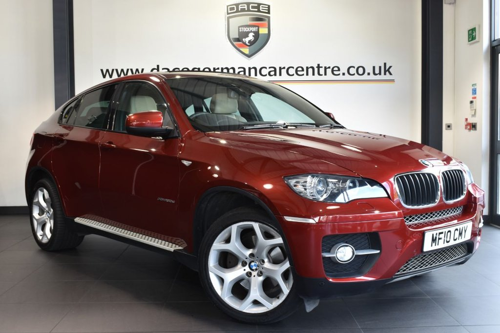 """USED 2010 10 BMW X6 3.0 XDRIVE30D 4DR AUTO 232 BHP full bmw service history Finished in a stunning vermillion metallic red styled with 20"""" alloys. Upon opening the drivers door you are presented with full leather interior, full bmw  service history, pro satellite navigation, panoramic unroof, bluetooth, rear-view camera with top view, heated sport seats with memory, xenon lights, adaptive headlights, cruise control, voice control, auto air con, rain sensors, light package, parking sensors"""