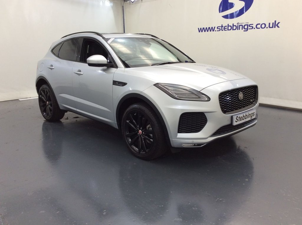 """USED 2018 18 JAGUAR E-PACE 2.0 R-DYNAMIC SE 5d AUTO 300 BHP PAN ROOF, SAT NAV, WIDESCREEN COLOUR TOUCHSCREEN MEDIA INTERFACE, VIRTUAL INSTRUMENT PANEL, LEATHER, POWER HEATED FRONT SEATS WITH MEMORY FUNCTION, MERIDIAN SOUND SYSTEM, DUAL ZONE CLIMATE CONTROL, REVERSE CAMERA WITH PARKING SENSORS, PARK ASSIST, AUTO LIGHTS AND WIPERS, HEATED STEERING WHEEL, CRUISE CONTROL WITH SPEED LIMITER, PRIVACY GLASS, 20"""" GLOSS BLACK ALLOYS"""