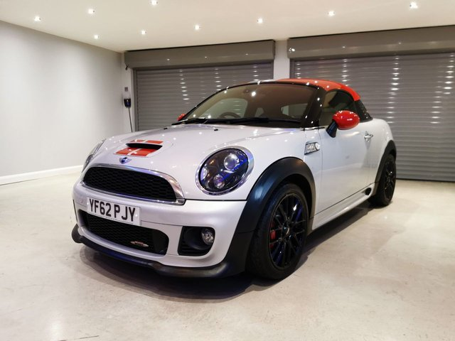 "USED 2013 62 MINI COUPE 1.6 JOHN COOPER WORKS 2d 208 BHP SATELLITE NAVIGATION + FULL LEATHER UPHOLSTERY + 18"" BLACK ALLOY WHEELS"