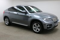 USED 2009 09 BMW X6 3.0 XDRIVE35D 4d AUTO 282 BHP Finished in stunning metallic Space Grey + 19 inch alloys + dark red leather interior + In car entertainment - CD / DVD + Air Con + Dual Climate control + Electric Memory seats + Full service history + Multi Function steering wheel + Cruise control + Electric Mirrors + Electric Windows + Auto lights / wipers + Electric Adjustable steering wheel