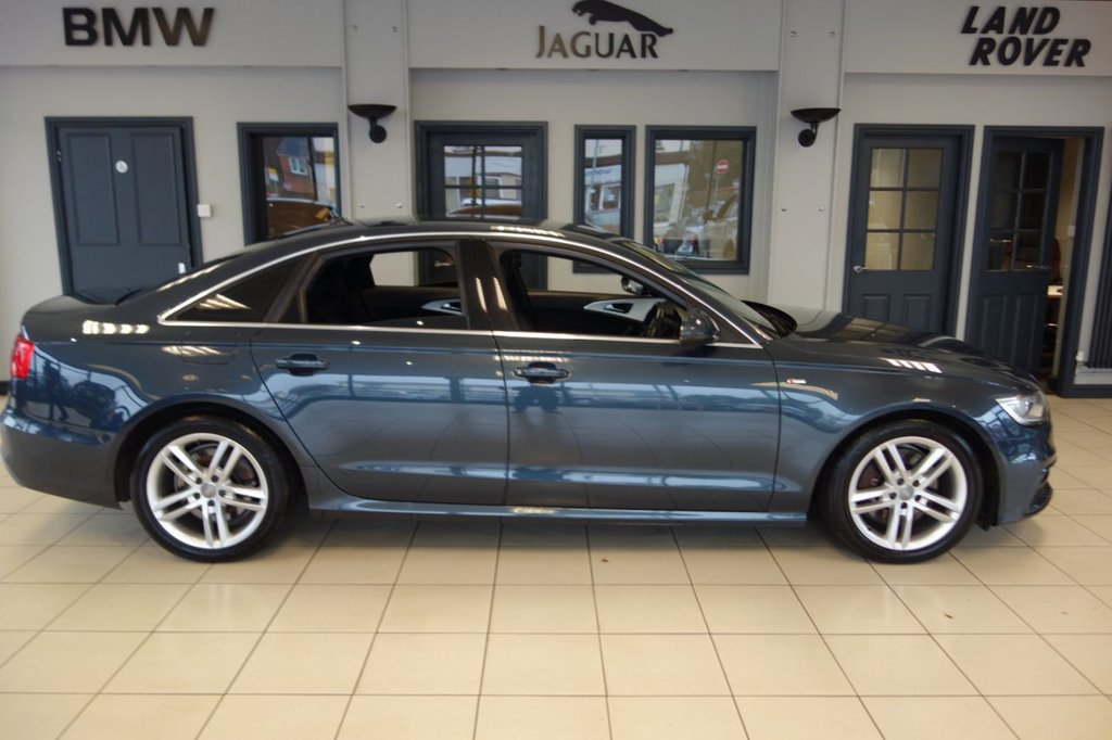 USED 2015 15 AUDI A6 3.0 TDI QUATTRO S LINE 4d AUTO 245 BHP FINISHED IN STUNNING METALLIC BLUE WITH FULL BLACK LEATHER S LINE EMBOSSED SEATS AND UPHOLSTERY + FULL SERVICE HISTORY + SATELLITE NAVIGATION + AUDI MULTIMEDIA + BLUETOOTH AUDIO + DAB DIGITAL RADIO + HEATED FRONT SEATS + HEATED STEERING WHEEL + PARKING SENSORS + PARK ASSIST + HEATED POWERFOLD MIRRORS + CRUISE CONTROL + AUTOMATIC HEADLIGHTS