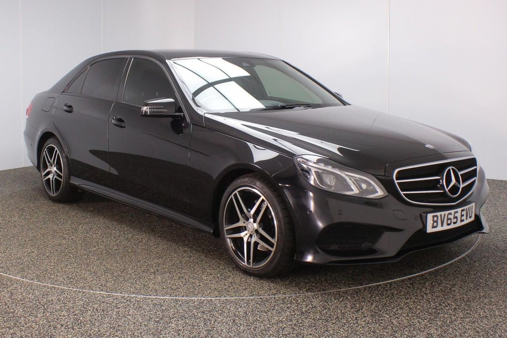 USED 2015 65 MERCEDES-BENZ E CLASS 2.1 E220 BLUETEC AMG NIGHT EDITION 4DR AUTO 174 BHP FULL SERVICE HISTORY + HEATED LEATHER SEATS + SATELLITE NAVIGATION + ACTIVE PARK ASSIST + PARKING SENSOR + BLUETOOTH + CRUISE CONTROL + CLIMATE CONTROL + MULTI FUNCTION WHEEL + DAB RADIO + ELECTRIC SEATS + XENON HEADLIGHTS + PRIVACY GLASS + ELECTRIC WINDOWS + ELECTRIC MIRRORS + 18 INCH ALLOY WHEELS