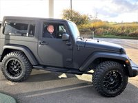 "USED 2013 63 JEEP WRANGLER 2.8 SAHARA CRD 2d AUTO 197 BHP Reserved For Daniel.... 1 Owner, Jeepster styled Wrangler with satellite navigation, Bluetooth, reversing camera, matte black 18"" Overland alloys wheels with A/T tyres (other options available, just ask) black leather upholstery with heated front seats, JEEPSTER stainless steel quad-pipe sports exhaust in black chrome, Gladiator front grille, LED headlights with Halo daytime running lights (DRL), LED rear lights, Cruise control, Climate control as well as removable hard-top panels, Privacy glass and sub-woofer."