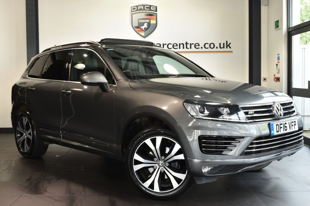 """USED 2016 16 VOLKSWAGEN TOUAREG 3.0 V6 R-LINE TDI BLUEMOTION TECHNOLOGY 5DR AUTO 259 BHP full service history Finished in a stunning grey styled with 20"""" alloys. Upon opening the drivers door you are presented with full black leather interior, full service history, satellite navigation, panoramic roof, bluetooth, xenon lights, heated seats, dab radio,  heated steering wheel, cruise control, climate control, heated electric folding mirrors, privacy glass, parking sensors"""