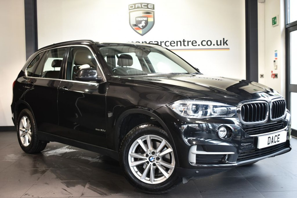 USED 2015 15 BMW X5 3.0 XDRIVE30D SE 5DR 7 SEATS AUTO 255 BHP  Finished in a stunning sapphire metallic black styled with 18 inch alloys. Upon opening the drivers door you are presented with full leather interior, full service history, pro satellite navigation, Reversing camera, bluetooth, xenon lights, heated seats, 7 seats, LED Fog lights, Driving Assistant, dab radio, Light package, Headlight cleaning system, Auxiliary heating/ventilation, Connected Drive Services, Automatic air conditioning, parking sensors