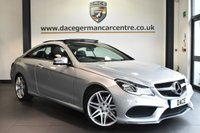 """USED 2014 14 MERCEDES-BENZ E CLASS 3.0 E350 BLUETEC AMG SPORT 2DR AUTO 252 BHP full service history Finished in a stunning iridium metallic silver styled with 19"""" alloys. Upon opening the drivers door you are presented with full leather interior, full service history, comand satellite navigation, bluetooth, panoramic sunroof, heated sport seats with memory, active park assist, dab radio, AMG styling package, air conditioning"""