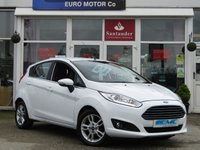 USED 2015 15 FORD FIESTA 1.0 ZETEC 5d 99 BHP STUNNING, ZERO ROAD TAX, FORD FIESTA 1.0 ZETEC TURBO, 5 DOOR. Finished in FROZEN WHITE with contrasting GREY Cloth interior trim. This Fiesta is a small car that you can really enjoy driving. Economical and cheap to run, stylish to look at and some great features. ZERO Road Tax with, SAT NAV,  DAB radio, B/Tooth, Alloys Air Con and much more, makes this a must for the first time driver or small family