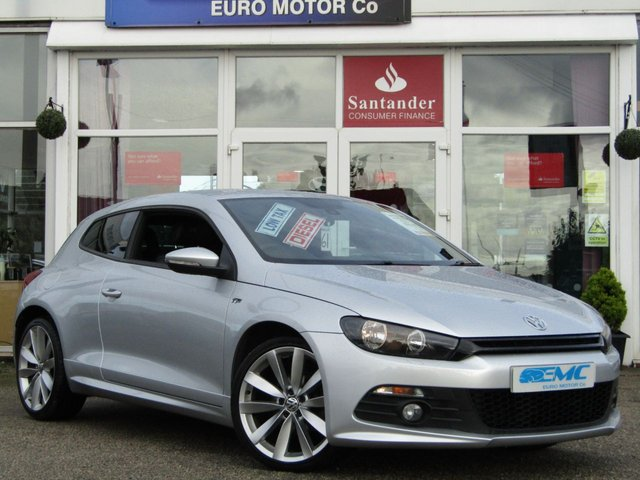 USED 2013 63 VOLKSWAGEN SCIROCCO 2.0 R LINE TDI BLUEMOTION TECHNOLOGY 2d 140 BHP VW SCIROCCO 2.0TDI R/LINE, BLUEMOTION. Finished in REFLEX SILVER METALIC with contrasting FULL EBONY HEATED LEATHER trim. This Sporty Scirocco is a good looking, well built and classy coupe. As well as looking good it's also great to drive and offers great economy. Only £30 Road Tax and a great 55.4 average mpg this one is not to missed. Features include, Sat Nav, DAB, Heated Leather, serviced at 9796 miles, 29567 miles, 38735 miles, & will be serviced by ourself's upon PDI & 12 month