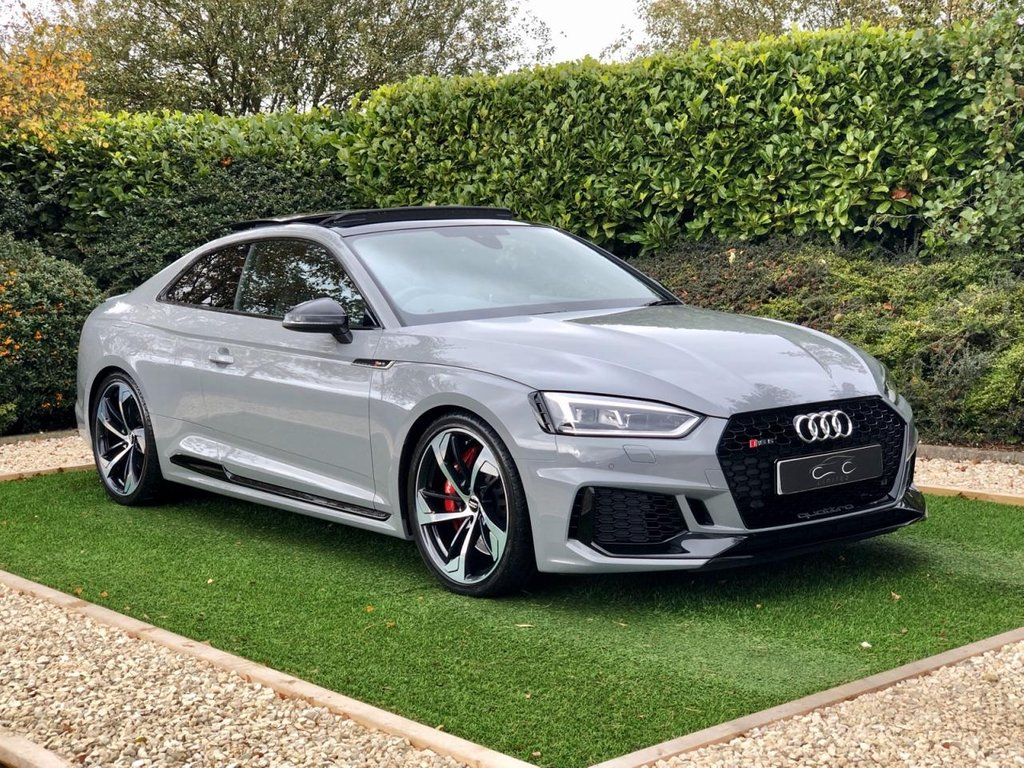 USED 2018 18 AUDI A5 2.9 RS 5 TSFI QUATTRO 2d AUTO 444 BHP High Spec and Incredible Performance with Quattro All Wheel Drive and Loaded with Impressive Features including over £8K of Optional Extras. Presented in Nardo Grey with Full Black Quilted Leather Heated Electric Sports Seats, RS Sports Exhaust, 20 Inch Anthracite Alloy Wheels with Red Brake Callipers. Features include Virtual Cockpit Satellite Navigation, Black Styling Pack, Carbon Fibre Inlays, Panoramic Sunroof, Extended LED Interior Lighting Pack, Comfort & Sound Pack and Privacy Glass.