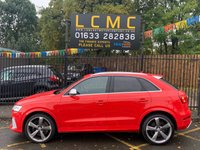 """USED 2015 15 AUDI Q3 2.5 RS TFSI QUATTRO 5d AUTO 335 BHP STUNNING MISANO RED METALLIC WITH FINE BLACK NAPPA LEATHER WITH DIAMOND QUILTING. PANORAMIC GLASS ROOF. 20"""" ROTOR ALLOY WHEELS. MMI SATELLITE NAVIGATION PLUS. REVERSE CAMERA. NON SMOKING PACK. PARKING SYSTEM PLUS. AUDI MUSIC INTERFACE. PHONE PREP BLUETOOTH. LIGHTING PACK. AIR CONDITION. CRUISE CONTROL. ELECTRIC WINDOWS. HILL HOLD ASSIST. ALUMINIUM STYLING PACK. AUTO DIMMING REAR VIEW MIRROR. PLEASE GOTO www.lowcostmotorcompany.co.uk TO VIEW OVER 120 CARS IN STOCK. SOME OF THE CHEAPEST ONLINE"""