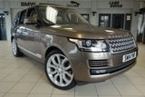 USED 2014 14 LAND ROVER RANGE ROVER 3.0 TDV6 VOGUE 5d AUTO 258 BHP FINISHED IN STUNNING NARA BRONZE WITH FULL LEATHER UPHOLSTERY + FULL LANDROVER SERVICE HISTORY + SATELLITE NAVIGATION + HEATED STEERING WHEEL + REAR CAMERA + PANORAMIC SLIDING SUNROOF + HEATED FRONT AND REAR SEATS + PARKING SENSORS + HEATED FRONT WINDSCREEN + DAB DIGITAL RADIO + ELECTRIC TAILGATE + AMBIENT LIGHTING + CRUISE CONTROL + ELECTRIC FRONT SEATS WITH DRIVER MEMORY + TV RECIEVER DIGITAL + XENON HEADLIGHTS + 22 INCH ALLOY WHEELS