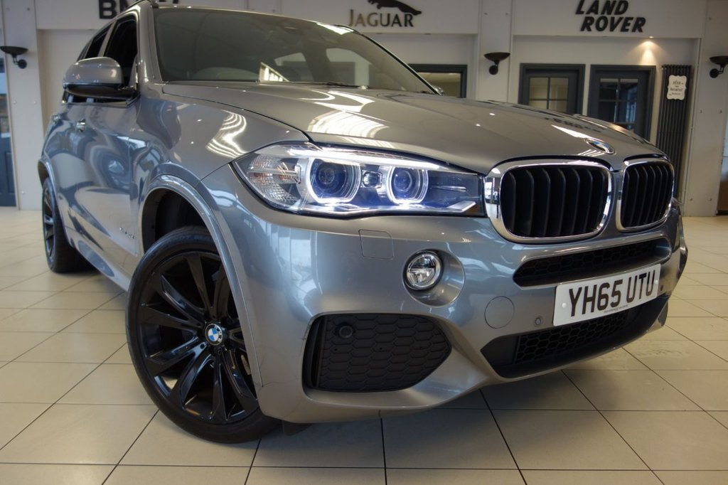 USED 2015 65 BMW X5 3.0 XDRIVE30D M SPORT 5d AUTO 255 BHP FINISHED IN STUNNING METALIC GREY WITH BLACK LEATHER HEATED SEATS + PROFESSIONAL SATELLITE NAVIGATION + CRASH SENSOR + HEATED FRONT SEATS + ELECTRIC MEMORY FRONT SEATS + DAB DIGITAL RADIO + CD/MP3/AUX + AIR CONDITIONING + AMBIENT LIGHTING + SELECTABLE DRIVING MODES + BLUETOOTH + DUAL ZONE AIR CONDITIONING + CRUISE CONTROL + REAR CAMERA + PRIVACY GLASS + ROOF RAILS + 20 INCH MSPORT BLACK ALLOY WHEELS + XENON HEADLIGHTS/ANGEL EYES....At Dace Specialist Car Centre, we are very proud to be named the