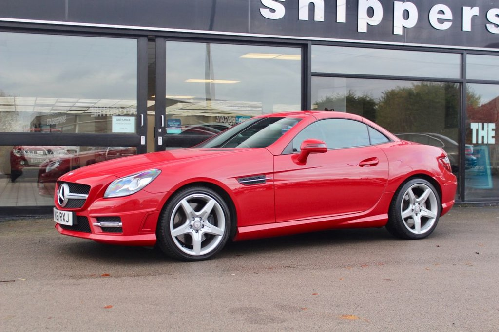 """USED 2011 61 MERCEDES-BENZ SLK 1.8 SLK200 BLUEEFFICIENCY AMG SPORT ED125 2d 184 BHP Opal fire Red SLK200 AMG Sport Edition 125, Advanced Parking Guidance, Heated Seats, Comand Online System With Media Interface, DA Radio, Automatic, 18"""" AMG Alloys, AMG Sport Package, Climate Control, Front and Rear Parking Sensors, Satellite Navigation, LED Daytime Running Lights, 2 Keys and Book Pack. Full Service History 8 services in total 6 carried out by Mercedes-Benz  last serviced by Mercedes-Benz at 30745 miles."""