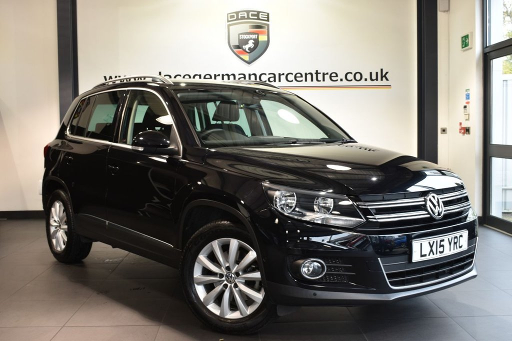 """USED 2015 15 VOLKSWAGEN TIGUAN 1.4 MATCH TSI BLUEMOTION TECHNOLOGY 5DR 158 BHP full vw service history Finished in a stunning black styled with 17"""" alloys. Upon opening the drivers door you are presented with cloth upholstery, full vw service history, satellite navigation, bluetooth, dab radio, park assist, multi-functional steering wheel, heated mirrors, air conditioning, parking sensors"""
