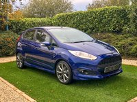 USED 2017 17 FORD FIESTA 1.0 ST-LINE 5d 100 BHP A Low Mileage High Spec Example with Fantastic Fuel Economy and an Impressive List of Features. Presented in Deep Impact Blue Metallic with 17 Inch 8 Spoke Alloy Wheels finished in Rock Metallic and ST-Line Sports Trim with Large Rear Spoiler and Side Skirt. Features Include Satellite Navigation, Ford SYNC Bluetooth Connectivity, Voice Control, DAB Radio, USB Connection, Air Conditioning, Quick Clear Windscreen, ST-Line Leather Multi Function Steering Wheel, Sport Seats...