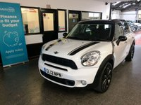 "USED 2012 12 MINI COUNTRYMAN 1.6 COOPER S 5d AUTO 184 BHP Fitted with over £5000 worth of extras, this petrol automatic Mini Countryman Cooper S is finished in white with Black heated leather seats, black roof, bonnet stripes and mirror caps. It is fitted with power steering, Panoramic opening sunroof, Mini Sat Nav, remote locking, Bluetooth phone, USB Aux port, 18"" Alloys, park assist, 4 x electric windows and mirrors, climate control, xenon lights with headlamp wash, cruise control and much more."