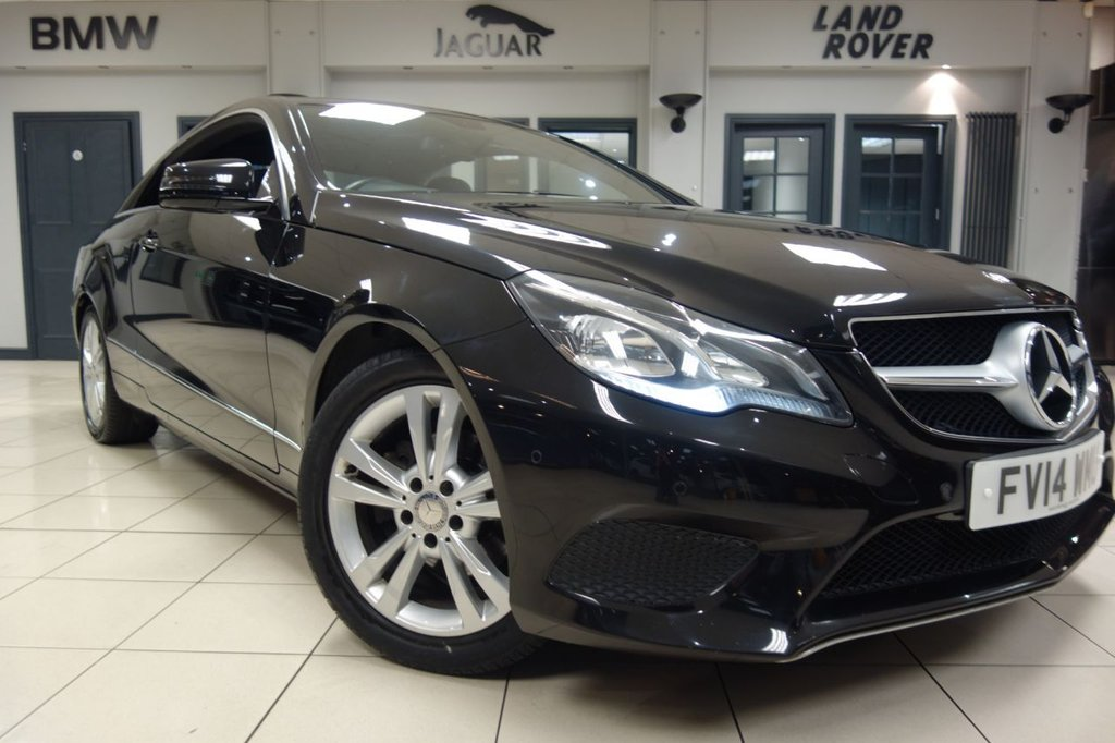 USED 2014 14 MERCEDES-BENZ E CLASS 2.1 E220 CDI SE 2d AUTO 170 BHP FINISHED IN STUNNING METALLIC BLACK WITH FULL BLACK LEATHER HEATED SEATS + COMES WITH AN IMPECCABLE MERCEDES SERVICE HISTORY + HEATED SEATS FRONT + PARKING SENSORS FRONT/REAR + SATELLITE NAVIGATION + DAB DIGITAL RADIO + DUAL ZONE AIR CONDITIONING + CRUISE CONTROL + BLUETOOTH + ELECTRIC SEATS + XENON HEADLIGHTS IN CAR ENTERTAINMENT CD/USB/AUX + SILVER MULTISPOKE ALLOY WHEELS