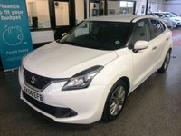 USED 2016 66 SUZUKI BALENO 1.2 SZ4 SHVS 5d 88 BHP HYBRID & Petrol,  this SZ5 Baleno is £0 Tax, ULEZ free and incredibly economical. It is finished in Superior White with Black cloth seats. It is fitted with power steering, reverse camera, Suzuki Satellite Navigation, Intelligent cruise control, DAB radio, climate control, LED Daylights, remote locking, electric windows and mirrors,  Bluetooth, alloy wheels and more. It has had one owner from new and comes with a full Suzuki service history done at 14587/27716/41400/50151 miles.