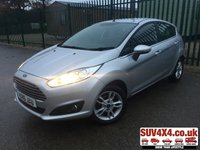 USED 2015 15 FORD FIESTA 1.0 ZETEC 5d 99 BHP ALLOYS CLIMATE BLUETOOTH  BODYKIT. STUNNING SILVER MET WITH CLOTH SPORTS TRIM. 15 INCH ALLOYS. COLOUR CODED TRIMS. PARKING SENSORS. REAR SPOILER. BLUETOOTH PREP. AIR CON. R/CD PLAYER. MFSW. MOT 11/20. SERVICE HISTORY. SUV4X4 USED CAR CENTRE LS23 7FQ TEL 01937 849492 OPTION 2