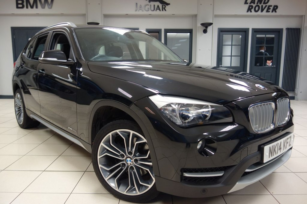 USED 2014 14 BMW X1 2.0 XDRIVE18D XLINE 5d 141 BHP FINNISHED IN STUNNING METALLIC SAPPHIRE BLACK WITH FULL BLACK LEATHER SEATS + 18 INCH Y SPOKE DIAMOND CUT ALLOY WHEELS + XLINE EDITION + HEATED SEATS + DAB DIGITAL RADIO + DUAL ZONE AIR CONDITIONING + CRUISE CONTROL + BLUETOOTH + SELECTABLE DRIVING MODES + ALUMINUM STYLING EXTERIOR TRIM + XLINE KICK PLATES + XLINE EMBOSSED HEADREST.... At Dace Specialist Car Centre, we are very proud to be named the first Stockport Trading Standards Approved Car Retailer, with process and procedures developed wi