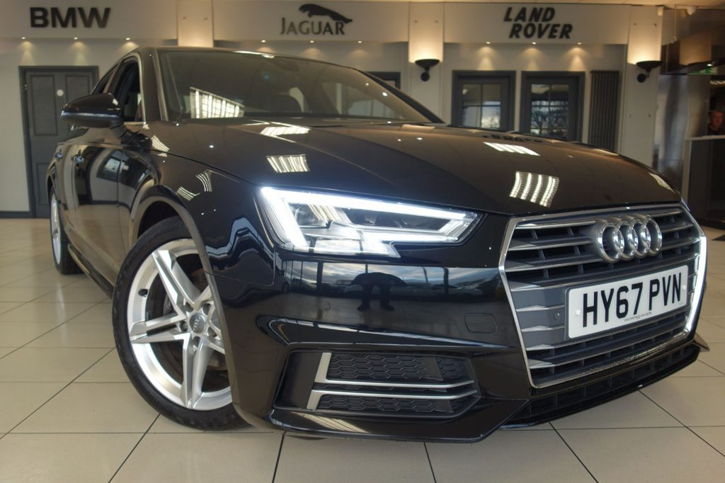 USED 2017 67 AUDI A4 2.0 TDI S LINE 4d 148 BHP S TRONIC AUTO FINISHED IN STUNNING METALLIC MYTHOS BLACK WITH HALF LEATHER HALF ALCANTARA HEATED SEATS + FULL AUDI MAIN DEALER SERVICE HISTORY + SATELLITE NAVIGATION + DRIVER DISPLAY + FRONT AND REAR PARKING SENSORS WITH PARK ASSIST + WIRELESS CHARGER PAD (PLACE YOUR PHONE ON A PAD AND IT CHARGES WITHOUT BEING PLUGGED IN) + REAR BLINDS + DAB DIGITAL RADIO + BLUETOOTH PHONE AND BLUETOOTH MEDIA + XENON HEADLIGHTS + LED RUNNING LIGHTS + CRUISE CONTROL + DUAL ZONE AIR CONDITIONING + CLIMATE CONTROL + ULEZ COMPLIA