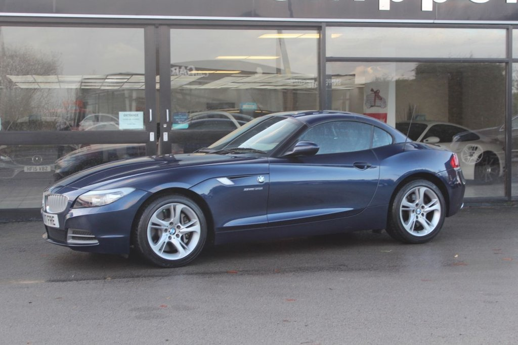 USED 2009 K BMW Z4 3.0 Z4 SDRIVE35I ROADSTER 2d 302 BHP Rare 1 Owner BMW Z4 35i In Deep Sea Blue Metallic, Rain Sensor, Multi Function Steering Wheel, Electric Seats With Memory, Sports Seats, Heated Black Leather Seats, Wind Deflector, Headlight Cleaning System, Electric Drivers Limbar  Support, Brushed Aluminium Interior Trim Strips, Light Package, Radio BMW Professional, BMW Alloys Wheels Turbine Styling 292, Velour Floor Mats, Isofix System,  Automatic Air Conditioning, Bluetooth Mobile Phone, 2 Keys and Book Pack, 6 Services Last done at 40,553