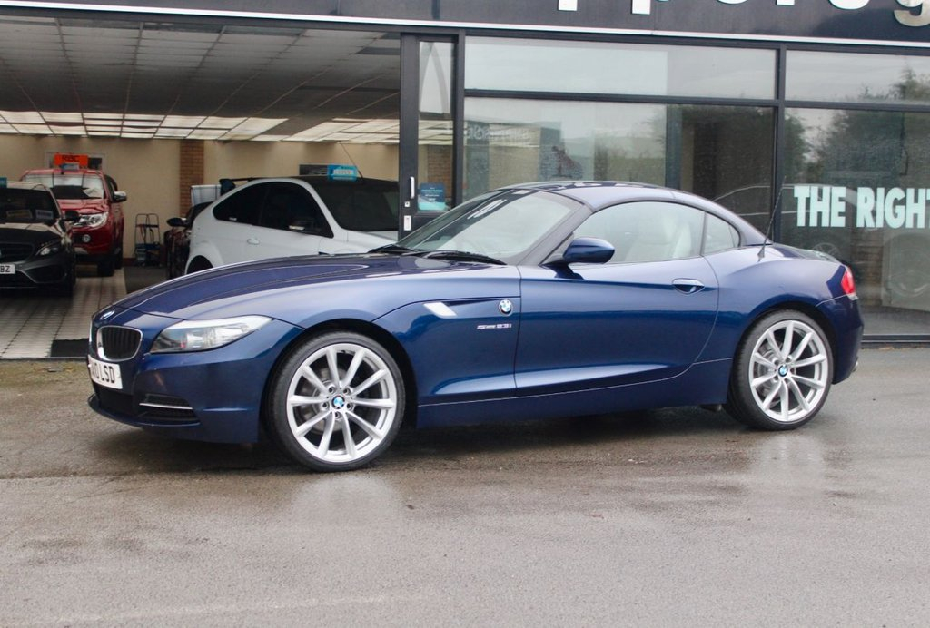 "USED 2010 10 BMW Z4 2.5 Z4 SDRIVE23I ROADSTER 2d 201 BHP High Specification Deep Sea Blue Metallic, Pure White Exclusive Design Package Costing £2640, 19"" Light Alloy V Spoke Style 296 Costing £1455, Heated Seats Costing £285, Sports Seats Csting £490, Wind Deflector Costing £210, Isofix System, Headlight Cleaning Unit, Automatic Air Conditioning, 2 Keys and Book Pack, Full Service History."