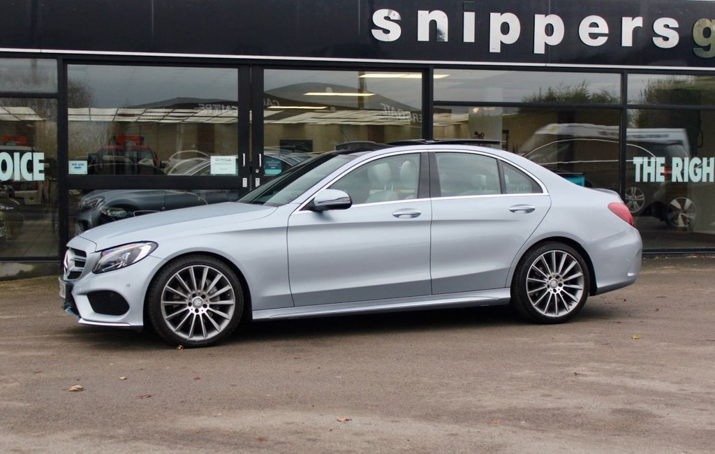 "USED 2016 16 MERCEDES-BENZ C CLASS 2.1 C220 D AMG LINE PREMIUM PLUS 4d 170 BHP Diamond Silver Metallic, Crystal Grey Leather Upholstery, 19"" Multispoke Alloy Wheels, COMANDD ONLINE Navigation, Burmester® surround soundsystem, Electric panoramic glass sunroof, Front & Rear Parking Sensors, Rear Camera, Keyless Go, Heated Front Seats, Cruise Control, Full Electric Windows, 2 Keys and Book Pack, Full Mercedes-Benz Service History Carried Out By Our Local Mercedes Dealer, Last Serviced at 32139 Miles."