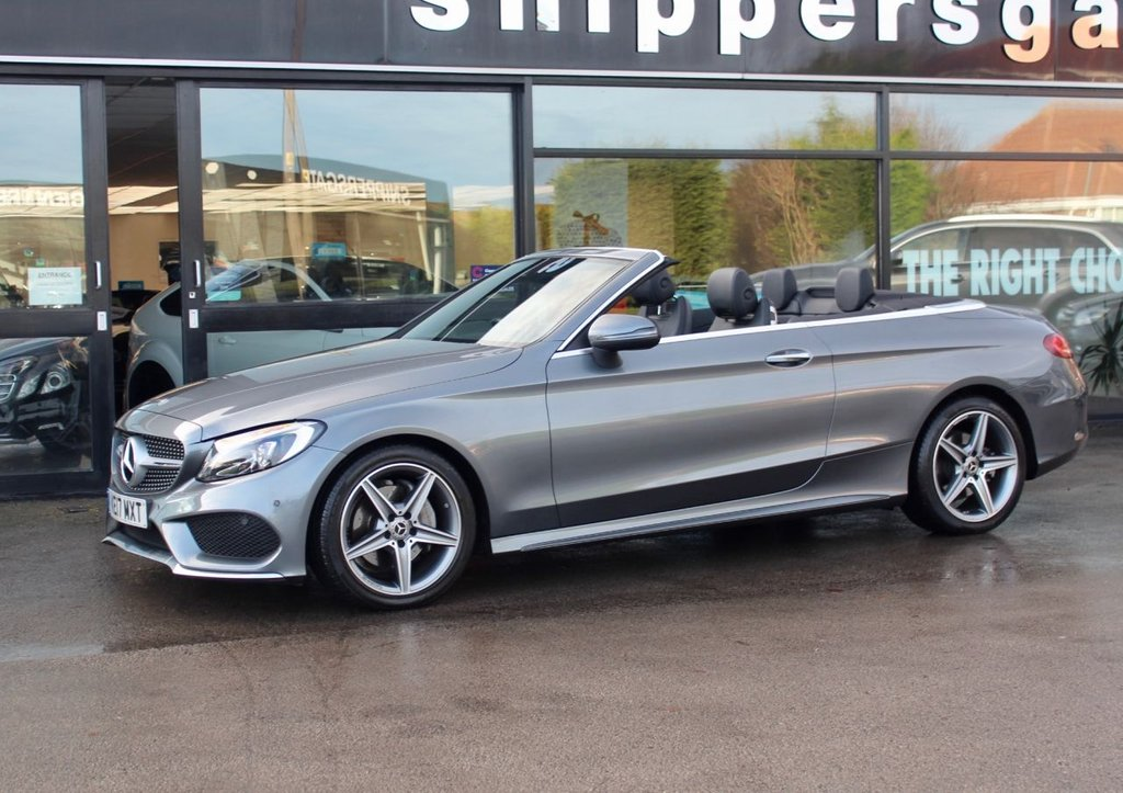 USED 2017 17 MERCEDES-BENZ C CLASS 2.1 C 220 D AMG LINE 2d  Great Specification 1 Owner Selenite Grey Metallic C220d AMG Line, AMG Styling Pack, Airtacarf Neck  Level Heating, Heated Seats, Bluetooth Phone, Parking Camera, Electric Adjustable Seats, Rain Sensor,  Active Park Assist, Satalite Navigation, 9 Speed Automatic, Cruise Control, Tyre Pressure Control, Electric Folding Mirrors, Ash Tree Black Wood Trim, Keyless Go, Mirrors Package, Parking Package, Convertible Comfort Package, Illuminated Door Sills, 2  Keys, Full Service History - Just Serviced.