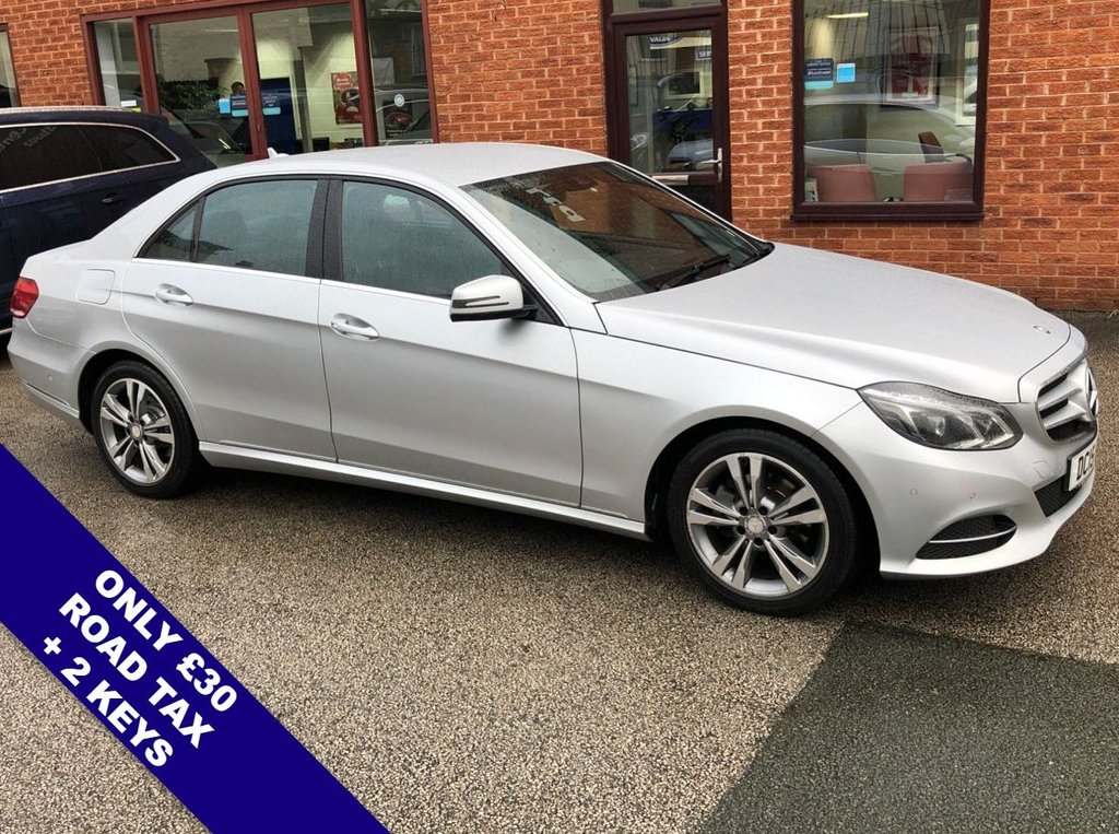 "USED 2015 15 MERCEDES-BENZ E CLASS 2.1 E220 BLUETEC SE 4DOOR 174 BHP DAB Radio   :   Satellite Navigation   :   USB Socket   :   Cruise Control / Speed Limiter      Bluetooth Connectivity   :   Climate Control / Air Con   :   Heated & Electric Front Seats      Remotely Operated Tailgate   :   Front & Rear Parking Sensors   :   17"" Alloy Wheels                   2 Keys   :   Comprehensive Service History"