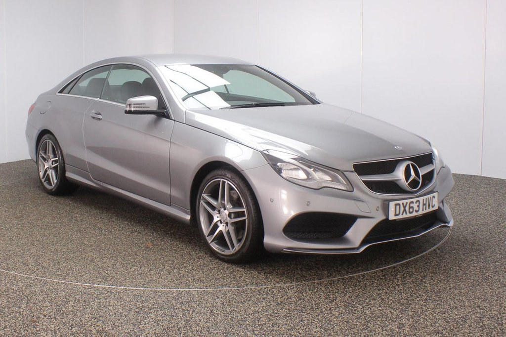 USED 2013 63 MERCEDES-BENZ E CLASS 2.0 E200 AMG SPORT 2DR AUTO HEATED LEATHER SAT NAV NEW SHAPE SERVICE HISTORY + HEATED LEATHER SEATS + SATELLITE NAVIGATION + ACTIVE PARK ASSIST + PARKING SENSOR + BLUETOOTH + CRUISE CONTROL + CLIMATE CONTROL + MULTI FUNCTION WHEEL + ELECTRIC SEATS + DAB RADIO + ELECTRIC WINDOWS + RADIO/CD/AUX/USB/SD + ELECTRIC/HEATED/FOLDING MIRRORS + 18 INCH ALLOY WHEELS