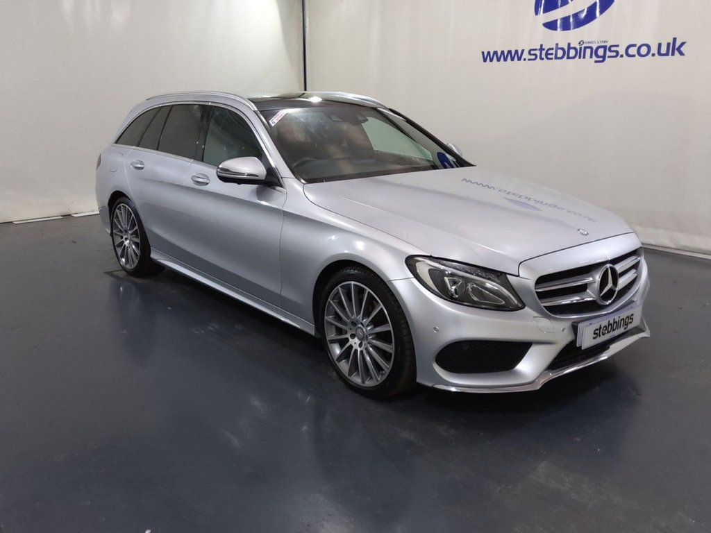 """USED 2016 16 MERCEDES-BENZ C-CLASS 2.1 C220 D AMG LINE PREMIUM 5d 170 BHP AUTOMATIC ESTATE PAN ROOF, SAT NAV, LEATHER, POWER HEATED FRONT SEATS WITH DRIVER MEMORY, MULTIMEDIA INTERFACE, DUAL ZONE CLIMATE CONTROL, CRUISE CONTROL WITH SPEED LIMITER, KEYLESS START, ACTIVE PARK ASSIST, 7 SPEED AUTOMATIC, LED HEADLIGHTS, AUTO LIGHTS AND WIPERS, POWER TAILGATE, AMBIENT LIGHTING, 19"""" AMG ALLOYS"""