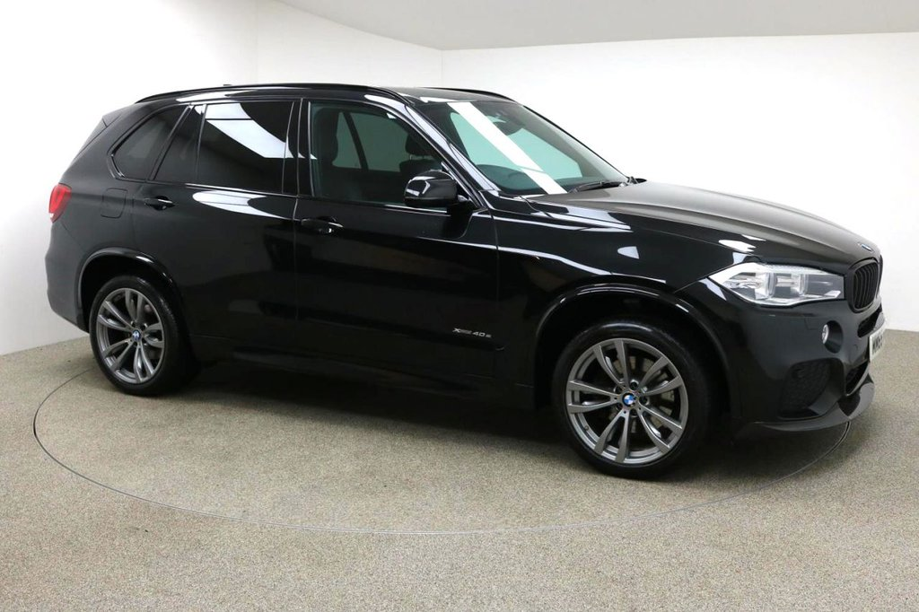 USED 2015 65 BMW X5 2.0 XDRIVE40E M SPORT 5d AUTO 242 BHP Finished in stunning Individual Azurite Black + 20 Inch M Sport Alloys + Full Black Leather Interior + CARBON FRONT SPLITTER + CARBON REAR DIFFUSER + PRIVACY GLASS + FRONT /  REAR PARKING SENSORS + ELECTRIC MEMORY SEATS + HEATED FRONT SEATS + PRO SAT NAV + BLUETOOTH + DAB RADIO + IN CAR ENTERTAINMENT - CD / AUX / USB + DUAL CLIMATE CONTROL + AIR CON + MULTI FUNCTION STEERING WHEEL + CRUISE CONTROL + ELECTRIC FOLDING MIRRORS + ELECTRIC WINDOWS + ELECTRIC POWERED BOOT + AUTO LIGHTS / WIPERS