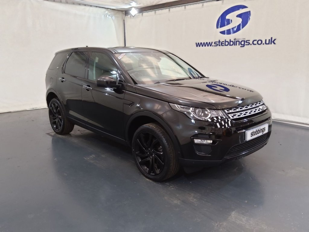 """USED 2015 65 LAND ROVER DISCOVERY SPORT 2.0 TD4 HSE LUXURY 5d 180 BHP 7 SEATS AUTOMATIC PAN ROOF, SAT NAV, LEATHER, 8 WAY POWER HEATED COOLING FRONT SEATS WITH MEMORY FUNCTION, HEATED REAR SEATS, STEALTH PACK, COLOUR TOUCHSCREEN MEDIA INTERFACE, DAB RADIO, IN CONTROL APPS, DUAL ZONE CONTROL CLIMATE CONTROL, CRUISE CONTROL, LANE DEPARTURE WARNING, KEYLESS ENTRY AND START, FULL PARK ASSIST WITH SENSORS, XENON HEADLIGHTS, AUTO LIGHTS AND WIPERS, HEATED STEERING WHEEL, POWER TAILGATE, 20"""" GLOSS BLACK ALLOYS"""