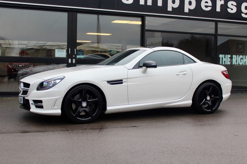 USED 2015 15 MERCEDES-BENZ SLK 2.1 SLK250 CDI BLUEEFFICIENCY AMG SPORT 2d 204 BHP Huge Factory Specification Diamond White Metallic SLK 250 CDI, Front and Rear Parking Sensors, 1 Previous Owner, Heated Seats, Analog Clock, Auto Dimming Mirrors, Rain Sensor, Airscarf, Glass Roof, Electric Folding Mirrors, Traffic Sign Recognition, Universal Communications Interface, Comand DVD With Navigation, DAB Radio, Automatic High Beam Switch, Ash Tree Black Interior Trim, AMG Sport Package, Mirrors Package, 2 Keys, Full Mercedes Service History - 4 Services last Done at 13261 Miles.