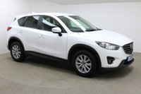 USED 2016 66 MAZDA CX-5 2.0 SE-L NAV 5d 163 BHP Finished in stunning pearl Crystal White + 17 inch alloys + Full black cloth interior + BLUETOOTH + DAB RADIO + IN CAR ENTERTAINMENT - CD / AUX / USB + AIR CON + DUAL CLIMATE CONTROL + MULTI FUNCTION STEERING WHEEL + CRUISE CONTROL + ELECTRIC FOLDING MIRRORS + ELECTRIC WINDOWS + AUTO LIGHTS / WIPERS + FRONT / REAR PARKING SENSORS + PRIVACY GLASS + FULL SERVICE HISTORY + 1 OWNER FROM NEW + ULEZ EXEMPT